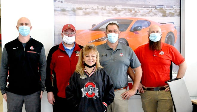 Employees at Serpentini's in Orrville showed their team spirit Monday, all dressed in Ohio State gear before the National Championship game. General sales manager Stephen Fusco is joined by Joe Freno, Marilyn Cruz, Pat Geiser and John Williams.