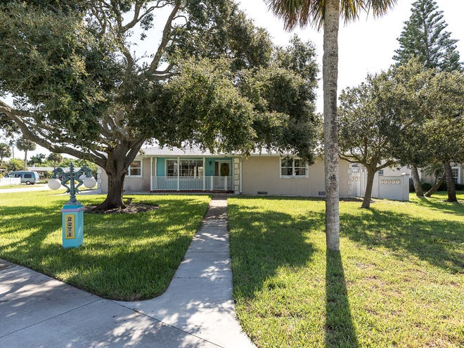 This three-bedroom Ormond Beach home, nestled between the Atlantic Ocean and the Intracoastal Waterway, is set on a corner lot that includes 100-feet of riparian rights.