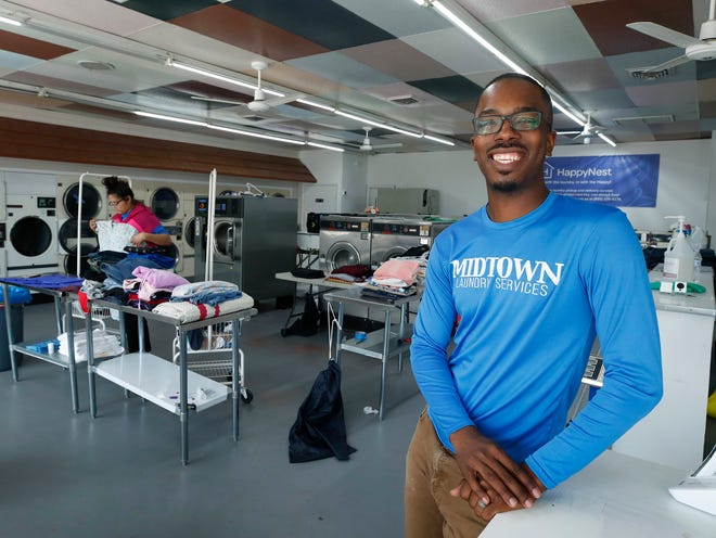 Mykal Tairu at his Midtown Laundry Services business in Holly Hill, Jan. 11.