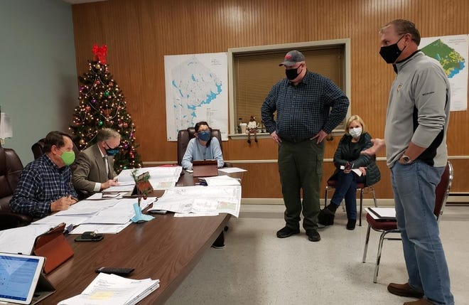 At the Paupack Township December meeting, resident Tom Nikles to the far right and Kelly Egan, an engineer from Kiley Associates LLC spoke to the board of supervisors about Nikles's troubles with a lot consolidation and the change of a road name.