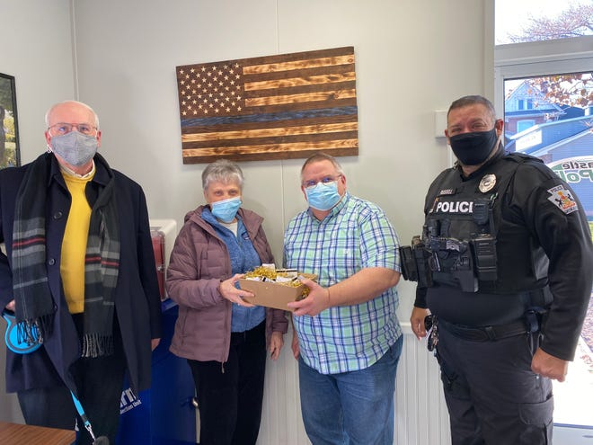 Representatives of Greencastle Presbyterian Church presented gift cards to members of the Greencastle Police Department last week for National Law Enforcement Appreciation Day, which was observed Saturday, Jan. 9. From left: Pastor Bob Cook; Debbie Young, missions chair; Police Chief John Phillippy; and officer Keith Russell.