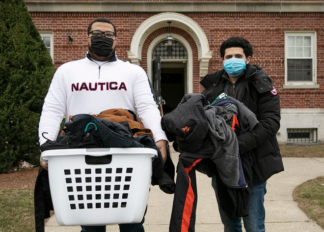 Brockton friends Jason Jenkins, 22, and Maxwell Moukit, 23, donate over 300 jackets to area shelters, delivering some of them to the Old Colony Y Family Life Center in Brockton on Monday, Jan. 11, 2021.