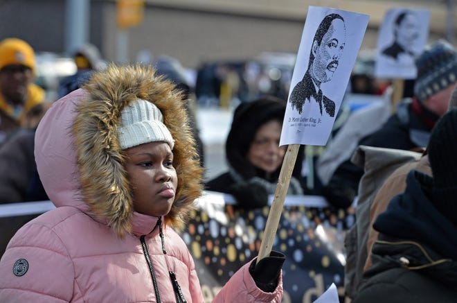 Jazareah Hines, 13, of Erie, was among about 250 participants in the 30th annual Martin Luther King Jr. Day march in Erie in 2020. There will be no march Monday.