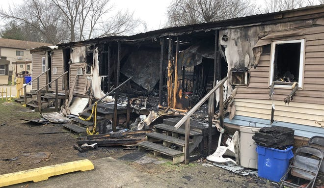 Firefighters on Monday morning returned to the scene of a blaze that damaged two mobile homes, shown here, in the Thunderbird Motel complex in Millcreek Township at West 12th Street and Harper Drive, west of Peninsula Drive, shortly after 10 p.m. on Sunday night. No one was injured in the fire.
