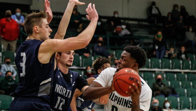 Carter Hendricksen (3) and Ryan Burkhardt (12) of the University of North Florida converge on Jacksonville's Dontarius James last week during JU's 66-65 victory. UNF will play at Lipscomb this weekend and JU is off.