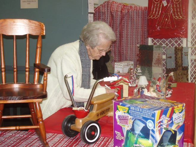 Hazel Petit organizes toys for resale at the Abilities Plus Resale Shop in Kewanee.