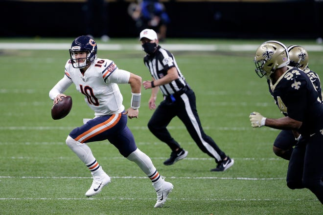 Chicago Bears quarterback Mitchell Trubisky (10) scrambles from New Orleans Saints defensive end Cameron Jordan (94) in the first half of Sunday's  wild-card playoff football game in New Orleans.