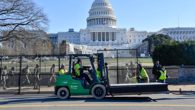 Security fencing goes up on Jan. 7, 2021 around the United States Capitol following the Wednesday riot by Pro-Trump supporters.