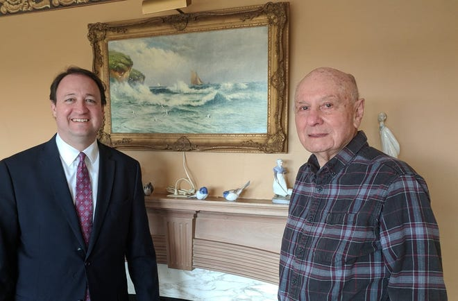 William Marshall, right, stands with Peoria Riverfront Museum CEO John Morris in Marshall's house in 2018. Marshall was found stabbed to death in his home on Jan. 6, 2021, and Robert Ely was arrested on Wednesday in the St. Louis area on a charge of first-degree murder in the incident. Marshall had been a generous donor to the Peoria Riverfront Museum as well as an avid art collector and sailor.