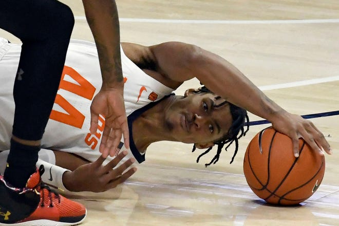 Illinois guard Adam Miller (44) battles for a rebound against Maryland in the first half of an NCAA college basketball game Sunday, Jan. 10, 2021, in Champaign, Ill. (AP Photo/Holly Hart)