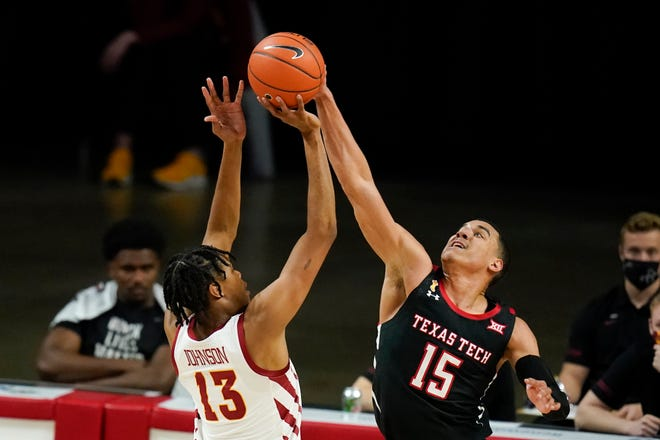 Texas Tech forward Kevin McCullar (15) blocks a shot by Iowa State forward Javan Johnson (13) during the Red Raiders' 91-64 victory at Hilton Coliseum in Ames, Iowa. Tech moved up three spots to No. 15 in The Associated Press Top 25 on Monday and visits No. 4 Texas on Wednesday.