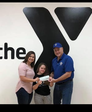 The North Central Missouri YMCA recently accepted a check for $368.77 from the Knights of Columbus Council #756 from Immaculate Conception Church in Brookfield.  The donation was the result of the Knights annual Tootsie Roll Drive and the money will be used for adaptive programs at the YMCA.  Pictured are:  Adaptive Gymnastics Instructor Tisha Jacquez, student Olivia McCurry and Knight Larry McCurry.