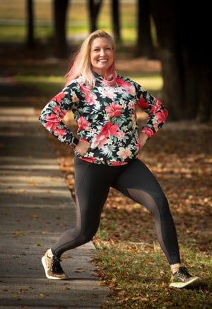 Marlo Alleva demonstrates a walking lunge.