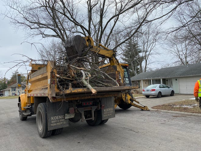 Lincoln City Street crews were busy Monday collecting the downed limbs caused by the New Year's ice storm. A city worker said he had made 12 trips to the landfill since starting his shift.