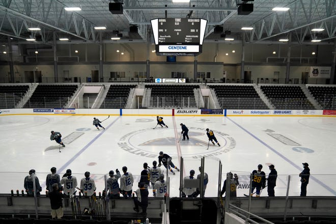 FILE - In this Jan. 5, Members of the St. Louis Blues practice during NHL hockey training camp in Maryland Heights, Mo. The Blues announced Monday, Jan. 11, 2021, that 300 fans will be allowed in for the home opener on Jan. 18 against San Jose.