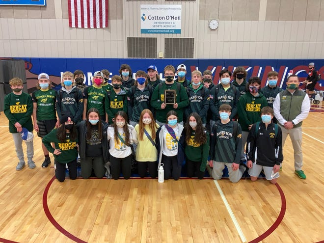 Shown are the Basehor-Linwood boy's and girls' wrestling teams Saturday at Seaman High School. Both teams went 3-0 and took first place in the Seaman Duals Tournament with wins against Lansing, Hays and Seaman.