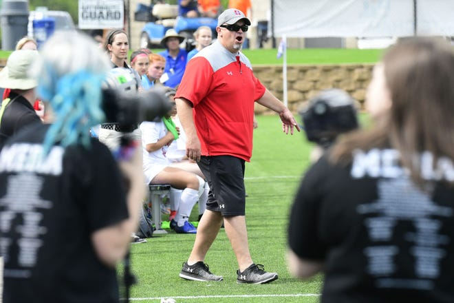 Heritage High School girls' soccer head coach Gerald Slovacek walks the sideline during the Class 4A girls' state championship match in 2018. Slovacek's Jaguars are off to a dominating start, with three shutout victories and an aggregate score of 19-0.