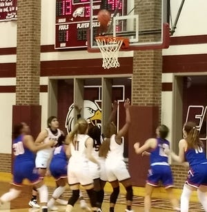 A Heritage shot draws a crowd under the basket during last Tuesday's game at Hillsboro. The Class 4A No. 13 Jaguars easily handled the shorthanded Lady Eagles, 57-19.