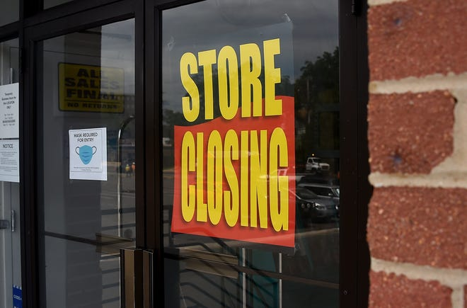 A store displays a sign before closing down permanently amid the coronavirus pandemic.
