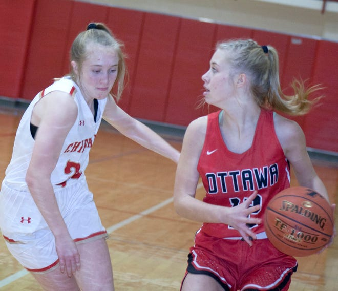 Ottawa High School senior Summer Spigle looks to make a play during Friday's win over Tonganoxie.