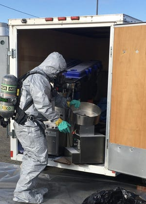 Authorities dismantle a Quincy-based illegal pill manufacturing operation.