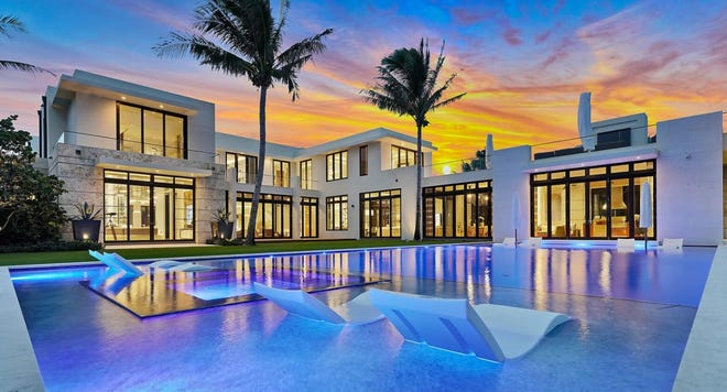 Priced at $140 million, a new Palm Beach house developed on speculation at 535 N. County Road has an oceanfront pool that serves as a focal point for many of the rooms.