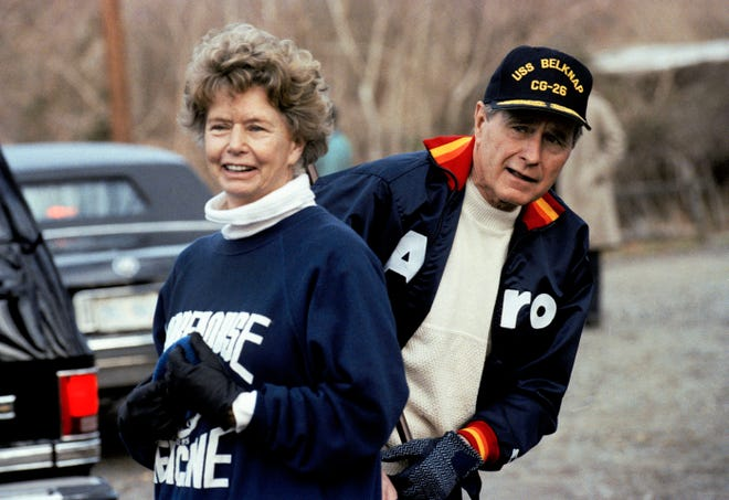 This Jan. 7, 1990, file photo shows President George H. W. Bush hiding behind his sister, Nancy Ellis, as he prepares for a jog along the C&O canal in the Georgetown section of Washington. A longtime Democrat who helped her Republican brother and nephew get elected president, died of complications of the coronavirus Sunday, Jan. 10, 2021, at an assisted living facility in Concord, Massachusetts. She was 94.
