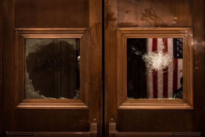 Broken glass on the doors to the entrance of the Capitol Rotunda in Washington on Jan. 6 after a pro-Trump mob stormed the Capitol and were cleared from the building.