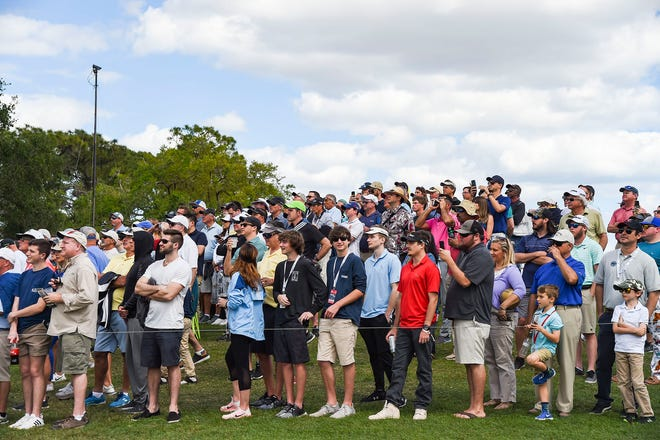 Spectators watch the action on the second hole tee during the final round of last year's Honda Classic at PGA National. The crowds will be limited in 2021 due to the coronavirus pandemic.
