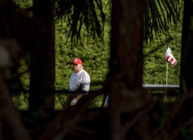 President Donald Trump plays golf at his Trump International Golf Club in West Palm Beach in December.  (Greg Lovett/The Palm Beach Post)
