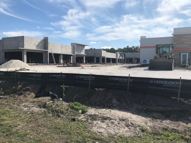 Plaza Delray, located just to the west of the recently purchased parcel, is beginning to take shape. The shopping plaza is expected to open by May 1.