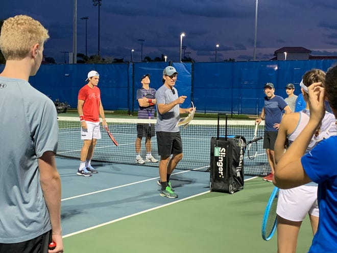 Scott Williams, center, and Tommy Haas, red shirt, teamed up to hold a tennis diversity camp at Palm Beach Atlantic University on Thursday, Jan. 7, 2021.