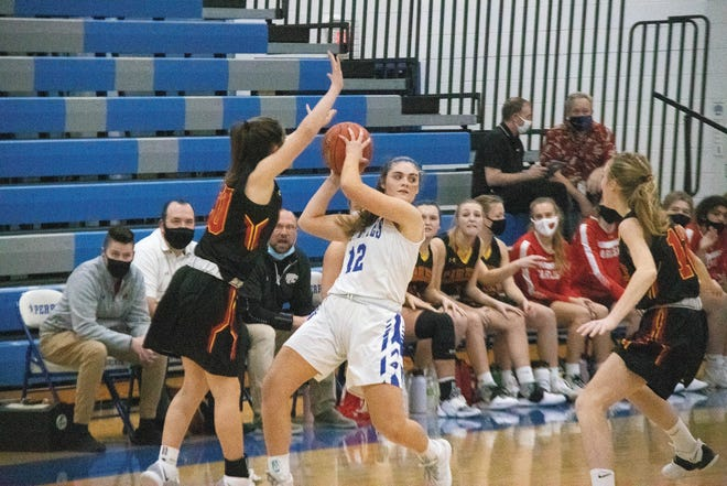 Perry's Jayna Kenney in action earlier this season. Perry and Woodward-Granger districts have issued new guidelines that will permit more fans for entry.