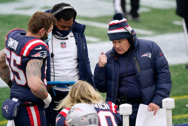 Patriots head coach Bill Belichick, right, instructs defensive lineman Chase Winovich, center, as inside linebackers coach Jerod Mayo instructs defensive end John Simon on the sideline in the first half of the season finale against the Jets on Sunday, Jan. 3.
