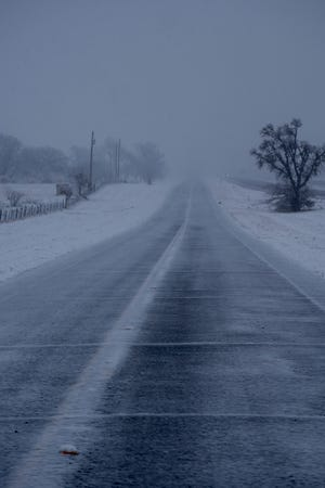 County roads and frontage roads were covered in snow for most of the day on January 10.