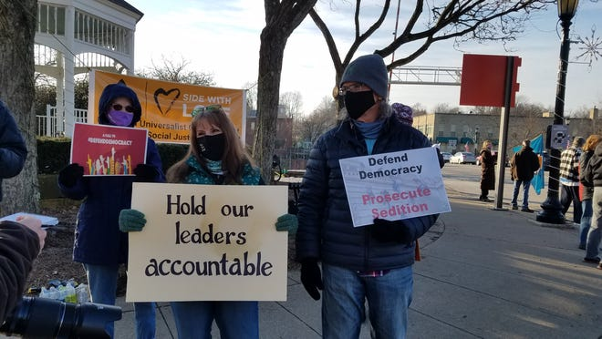 Members of the Unitarian Universalist Church of Kent held a pro-democracy rally at the gazebo in Kent on Sunday.