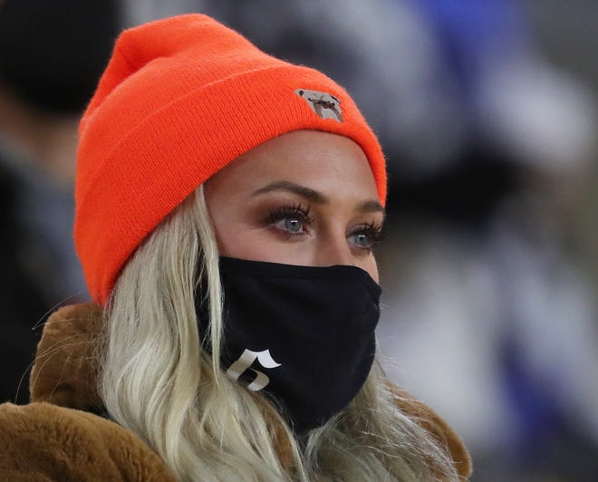Emily Mayfield watches her husband Baker work during the second half of an AFC wild-card playoff game against the Steelers, Sunday, Jan. 10, 2021, in Pittsburgh. (Jeff Lange/Beacon Journal)