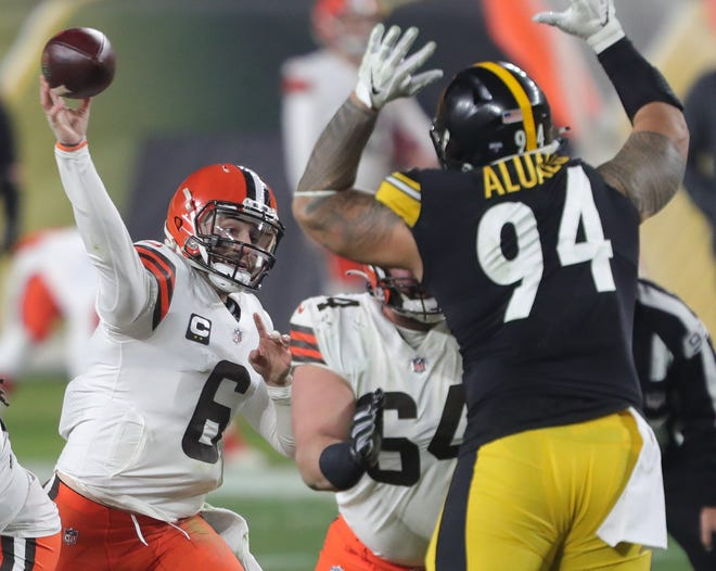 Browns quarterback Baker Mayfield (6) makes a pass against Steelers nose tackle Tyson Alualu (94) during the first half of an AFC wild-card playoff game, Sunday, Jan. 10, 2021, in Pittsburgh. [Jeff Lange/Beacon Journal]