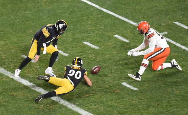 Steelers quarterback Ben Roethlisberger (7) and running back James Conner (30) try to recover a fumble that was recovered by the Browns for a touchdown in the first half of an AFC Wild Card playoff game, Jan. 10, 2021, in Pittsburgh. (Philip G. Pavely-USA TODAY Sports)