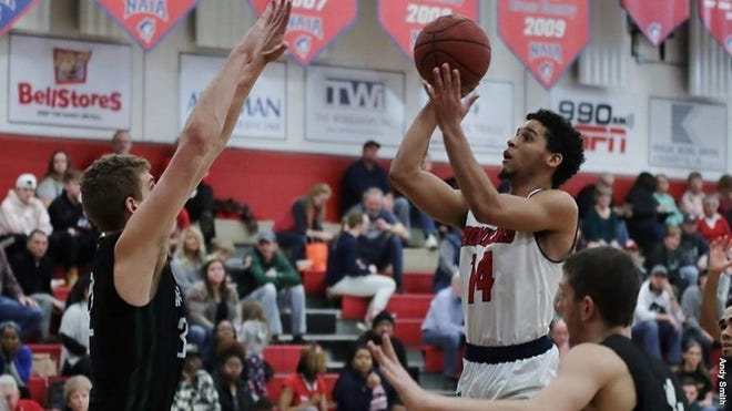 Malone's Bryce Butler (14), shown here prior to this season, scored 24 points for the Pioneers on Sunday against Hillsdale. (Malone University / Andy Smith)