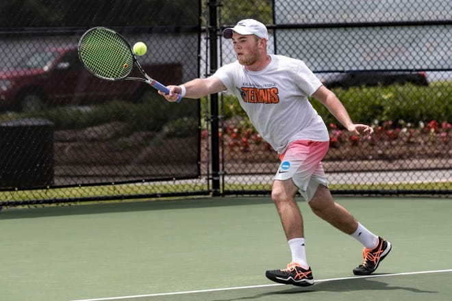 Former Auburn tennis star Branden Metzler reaches for a forehand while playing for Kalamazoo college. Metzler reached the NCAA Division III semifinals twice at Kalamazoo, taking second in the nation in 2016.