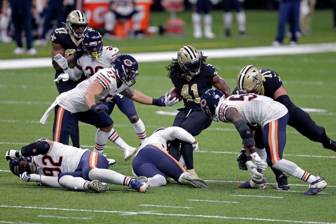 New Orleans Saints running back Alvin Kamara (41) carries for a first down during their NFL wild-card playoff game against the Chicago Bears in New Orleans, Sunday, Jan. 10, 2021.