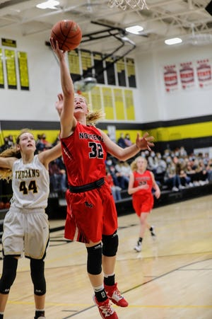 Reagan Barkema goes up for a shot during Roland-Story's 39-38 victory at West Marshall Friday in State Center. Barkema had 11 points and six steals in the win.