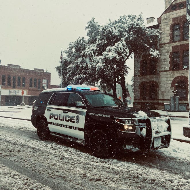 A Stephenville Police patrol unit makes its way across snow- and slush-covered streets during Sunday's winter storm.