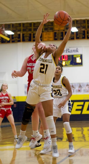Stephenville's Alee McClendon (21) goes up high for a rebound in front of Glen Rose's Jean Douglas on Friday night. The No. 14 Honeybees (14-1, 1-0) pulled off a 40-34 upset of the No. 7 Lady Tigers (18-2, 1-1). McClendon led the Honeybees with 16 points and Mya Wilson added nine points. Stephenville is back in action Tuesday when they travel to Lampasas.