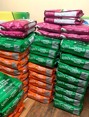 Bags of dog food wait to be loaded on a truck at RollOver Pets on Monday.