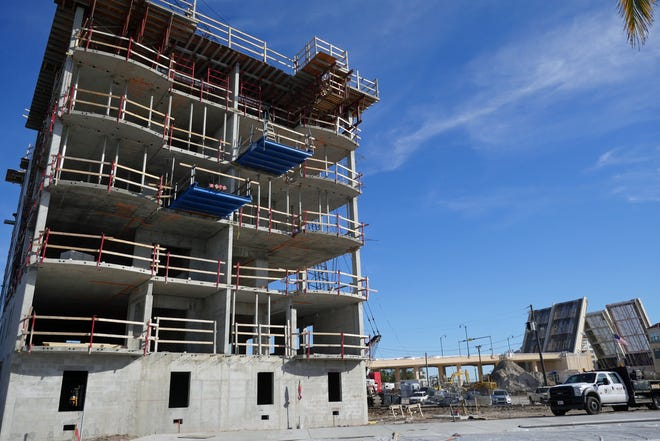 Construction proceeds on Jan. 6, 2021, on the first of three Porto Vista condominium buildings at the Fisherman's Wharf property, on the west side of the KMI Bridge. The topping out ceremony for that first building occurred last week.