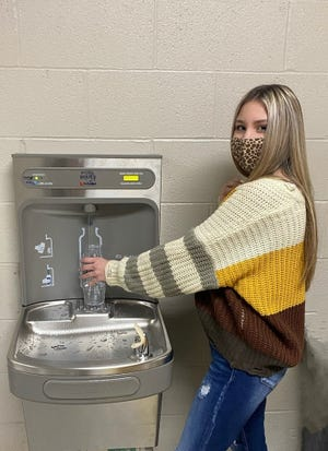 Tecumseh High SchoolJunior Rylee McMillan tries outawater bottle filling station for the first time.