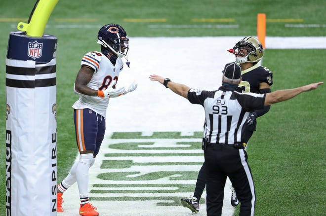 Bears receiver Javon Wims and Saints cornerback Marshon Lattimore react after Wims dropped a pass in the end zone in the first quarter.