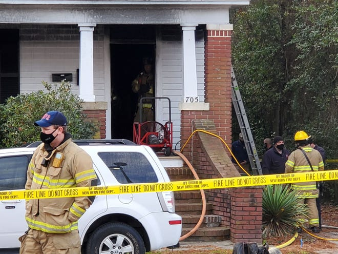 The New Bern Fire Department and other first responders help battle a house fire on Broad Street in downtown New Bern early Monday morning. Officials confirmed one man was unable to make it out of the house and was pronounced dead at the scene.